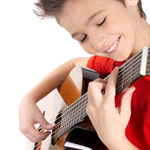 child-learning-guitar